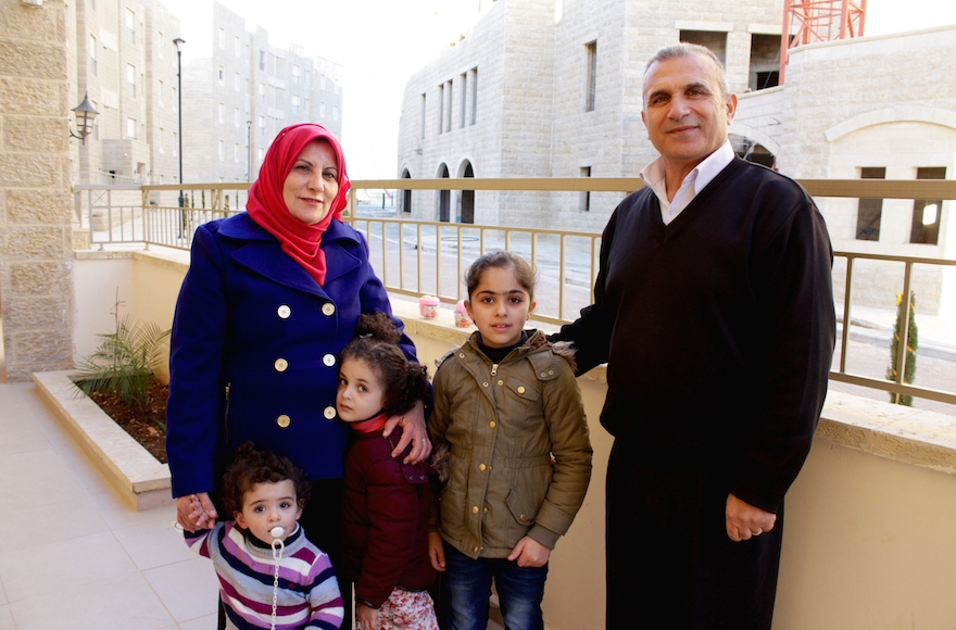 Basim Dodin, right, and his wife Asma are among the first Palestinian residents of Rawabi. (Yardena Schwartz)