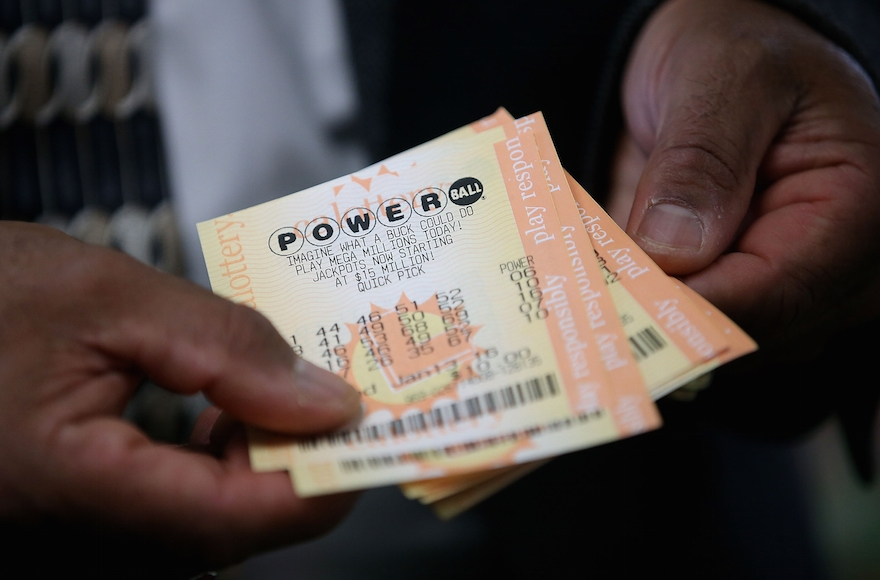 A customer holding Powerball tickets in San Lorenzo, California, Jan. 12, 2016. (Justin Sullivan/Getty Images)