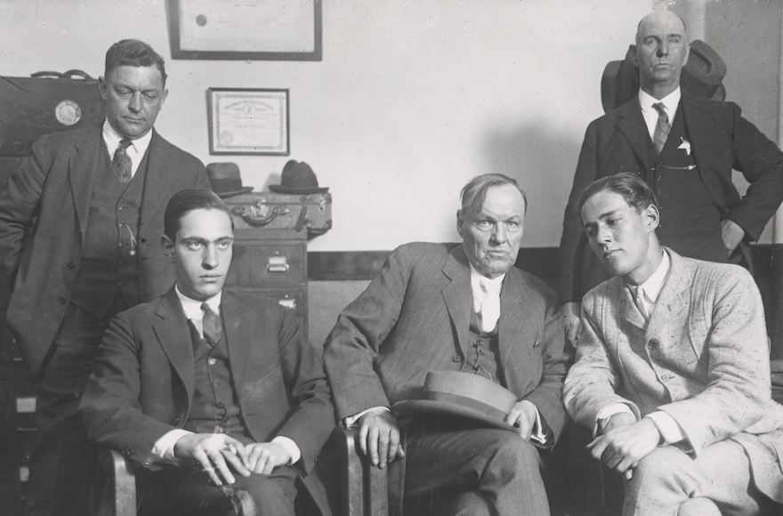 Defense attorney Clarence Darrow, center, meets with his clients Nathan Leopold (seated left) and Richard Loeb (seated right) in 1924. (Courtesy of Charles Deering McCormick Library of Special Collections, Northwestern University)