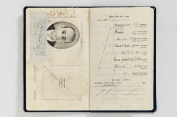 "Falsified Israeli passport prepared for Adolf Eichmann in the name of ""Ze'ev Zichroni,"" including a photograph that was taken and developed in a safe house, 1960. (Mossad Archive)"