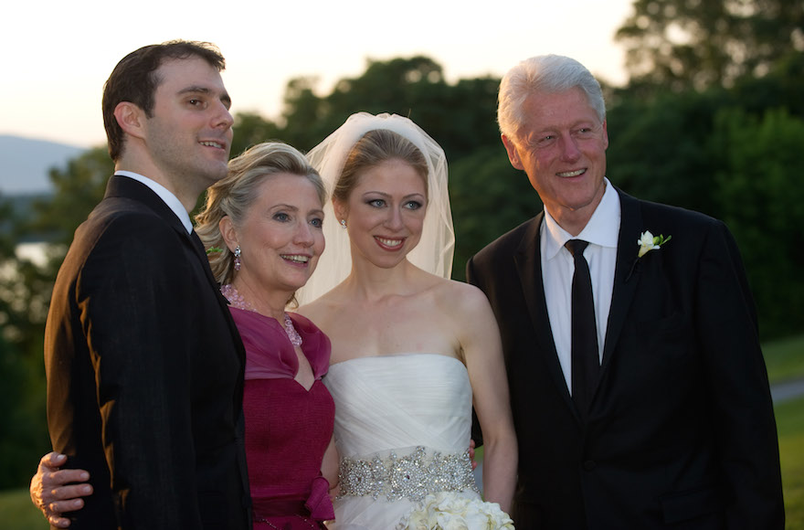 Left to right: Marc Mezvinsky, U.S. Secretary of State Hillary Clinton, Chelsea Clinton and former U.S. President Bill Clinton posing during the wedding of Chelsea Clinton and Marc Mezvinsky at the Astor Courts Estate in Rhinebeck, New York, July 31, 2010 . (Barbara Kinney/Matt McKenna via Getty Images)