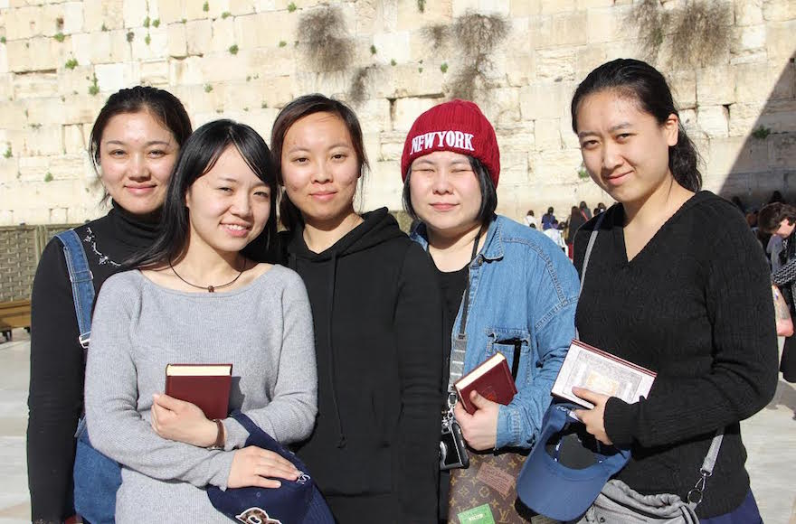 From left to right: Li Yuan, Yue Ting, Li Jing, Li Chengjin and Gao Yichen standing in front of the Western Wall in Jerusalem, Israel, Feb. 29, 2016.