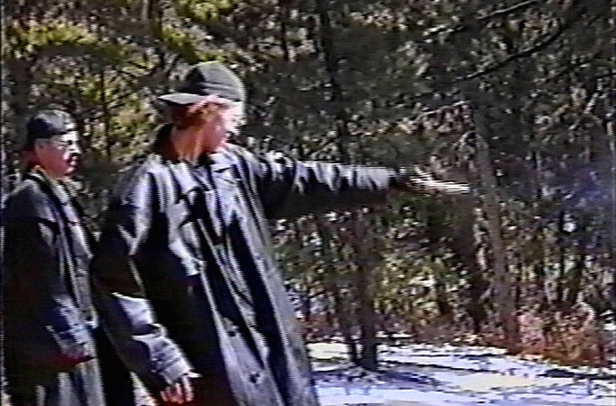 Eric Harris, left, watching as Dylan Klebold practices shooting a gun at a makeshift shooting range in Douglas County, Colorado, March 6, 1999. (Jefferson County Sheriff's Department via Getty Images)