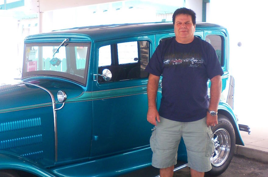 David Bak, alongside the 1932 Chevrolet Model A he restored, found a friend he worked with at a Haifa auto repair shop in the late 1960s. (Courtesy of David Bak)