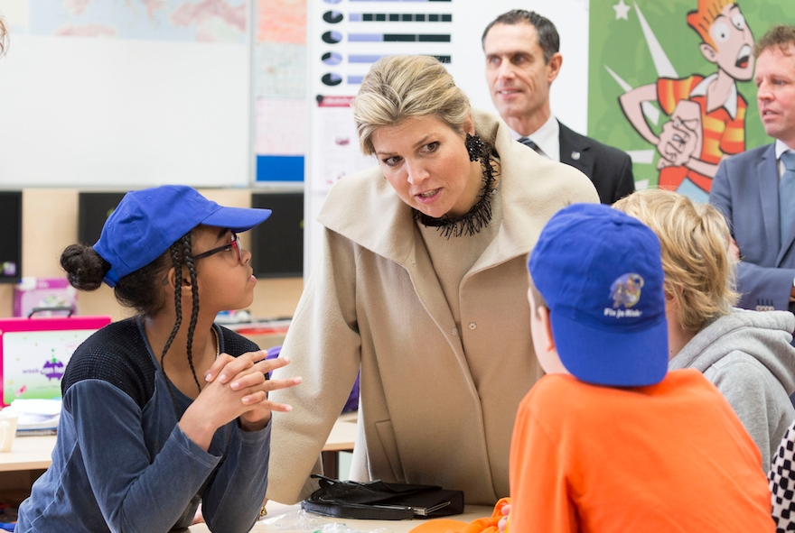 Queen Maxima of The Netherlands talking with students at the OBS West Primary School in Capelle aan den Ijssel, The Netherlands, March 9, 2015. Michel Porro/Getty Images)