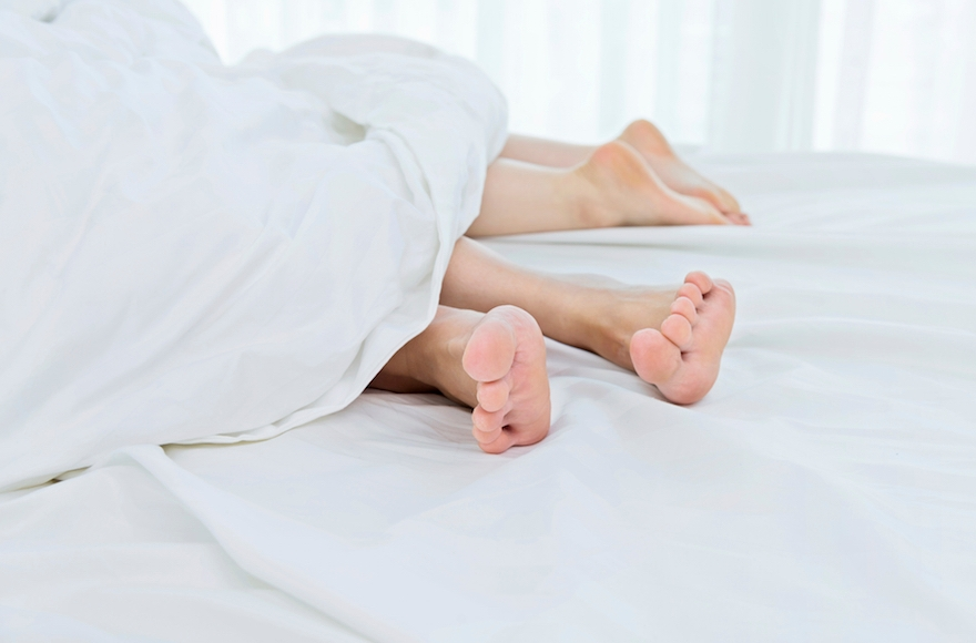 A couple in bed (iStock)