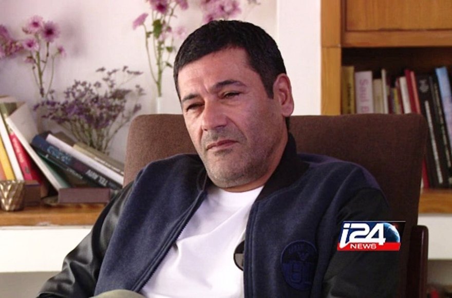 Gilbert Chikli giving an interview at his Ashdod home, Dec. 29, 2015. (Courtesy of i24 News)