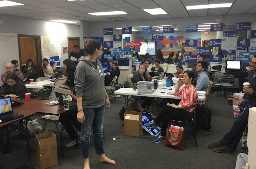 Volunteers work the phones at a Las Vegas suburban office if the Hillary Clinton campaign while watching a debate between Clinton and Sen. Bernie Sanders, I-Vt, Feb. 11, 2016. (Ron Kampeas)