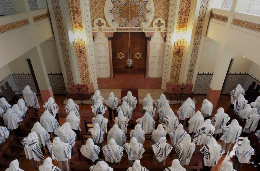 Congregants praying at the Kadoorie - Mekor Haim synagogue in Porto, Portugal, May 2014. (Courtesy of the Jewish Community of Porto)