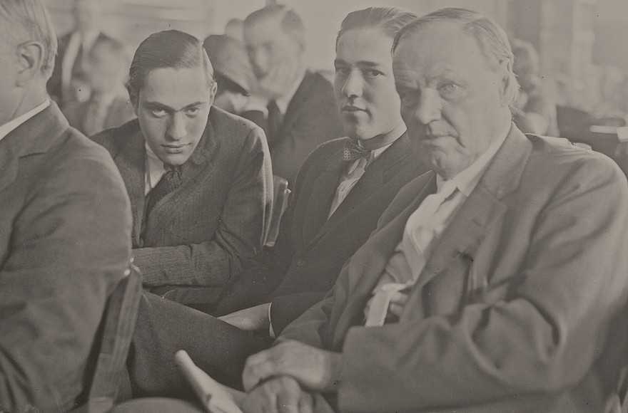 Nathan Leopold (left) and Richard Loeb (center), sitting in the courtroom with their defense attorney, Clarence Darrow (right) on July 24, 1924. (Courtesy of Chicago History Museum)