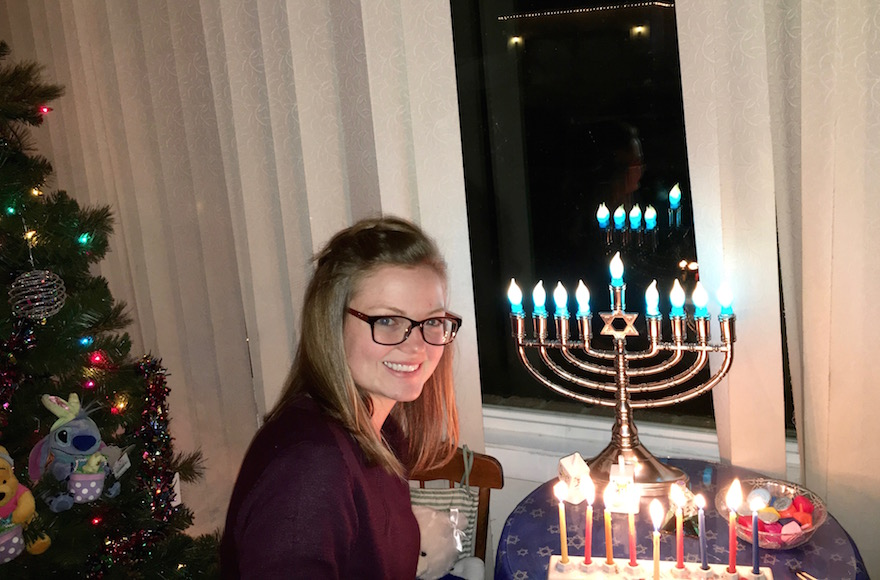 Phyllis Miller's daughter Kaytlyn lighting Hanukkah candles. (Courtesy of Phyllis Miller)