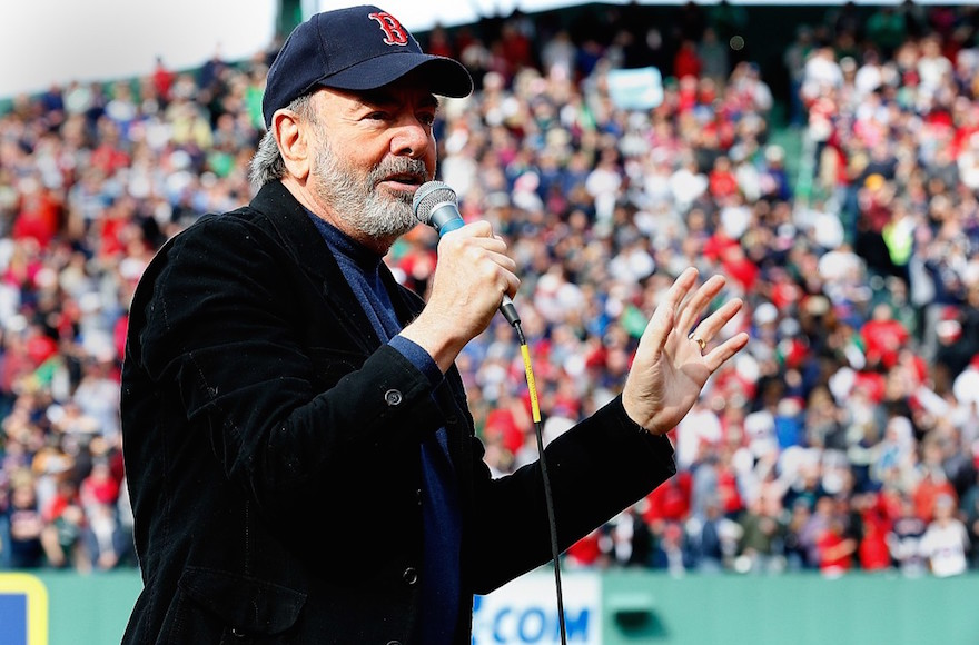 "Neil Diamond singing ""Sweet Caroline"" during a Boston Red Sox  game at Fenway Park, April 20, 2013. (Jim Rogash/Getty Images)"