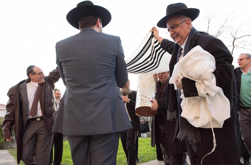Turkish Chief Rabbi Ishak Haleva, right, talking to congregants outside Kadoorie - Mekor Haim synagogue in Porto, Portugal, Jan. 29, 2016 (Cnaan Liphshiz)