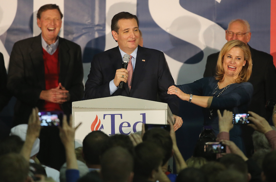 Republican presidential candidate Sen. Ted Cruz R-Tx., standing with his wife, Heidi Cruz, as he addresses supporters at the  caucus night gathering at the Iowa State Fairgrounds in Des Moines, Iowa, Feb. 1, 2016. (Christopher Furlong/Getty Images)