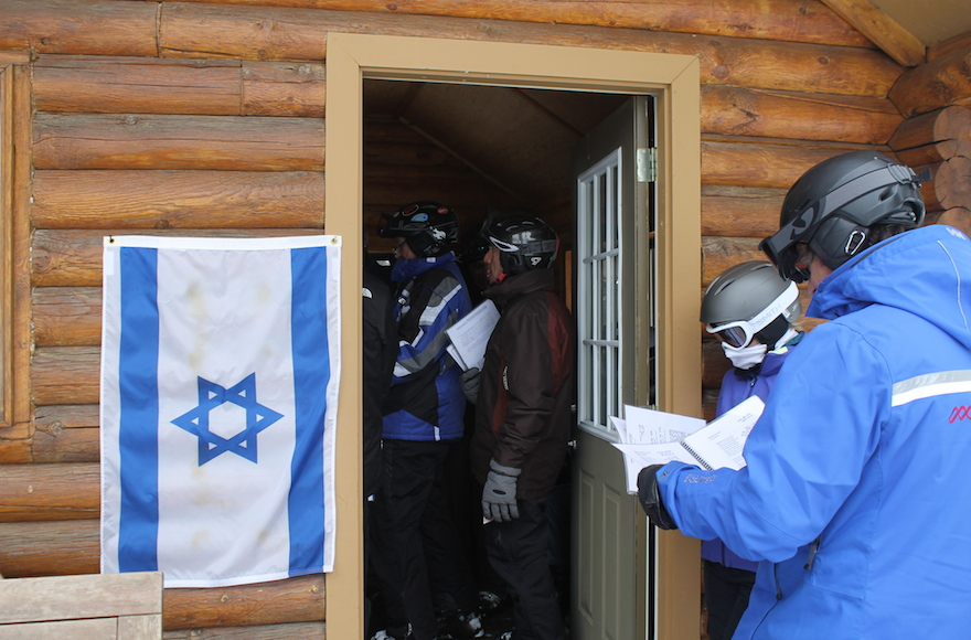 An Israeli flag is posted at Deer Valley's Sunset Cabin every Friday afternoon to alert skiers to the weekly Kabbalat Shabbat service. (Uriel Heilman)