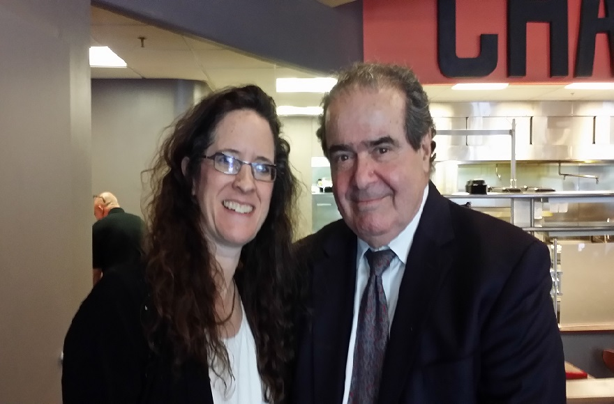 Supreme Court Justice Antonin Scalia with Alyza Lewin, daughter and law partner of Nathan Lewin, at the Char Bar kosher restaurant in Washington, D.C., May 2015. (Courtesy of Nathan Lewin)