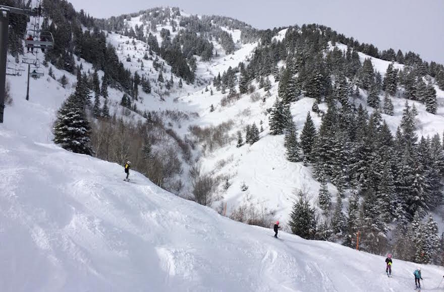 People skiing at Snow Basin, Utah.