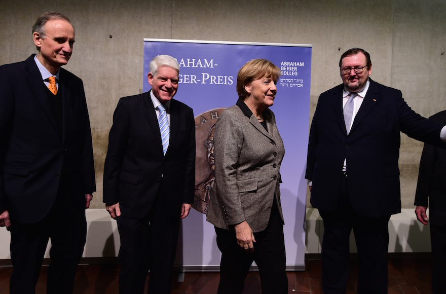 German Chancellor Angela Merkel, center, and President of the Central Council of Jews in Germany Josef Schuster, to her left, meeting at the Jewish Museum in Berlin, Germany, Dec. 2, 2015/ (John MacDougall/AFP/Getty Images)