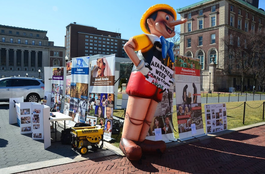 During Israel Apartheid Week at Columbia University, pro-Israel students countered anti-Israel displays with a 12-foot-tall Pinocchio doll meant to call attention to