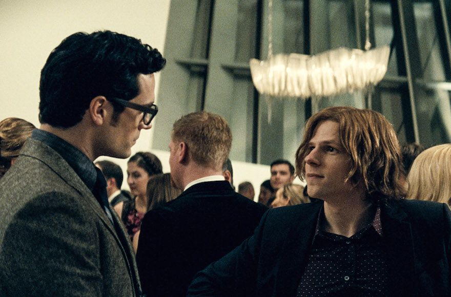 "Henry Cavill as Clark Kent, Jesse Eisenberg as Lex Luthor and Ben Affleck as Bruce Wayne in ""Batman v. Superman: Dawn of Justice."" (Courtesy of Warner Bros. Pictures/DC Comics)"