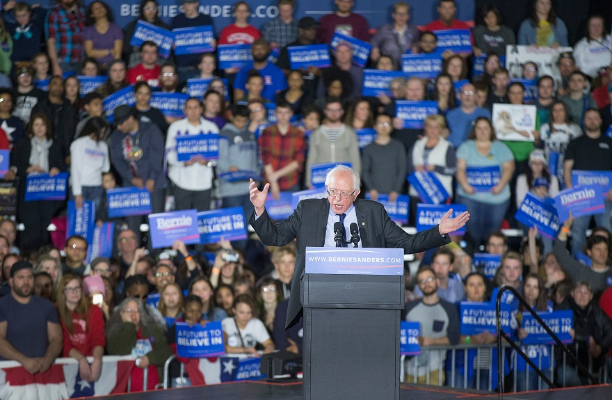 Democratic candidate Bernie Sanders speaking at a rally in Madison, Wis., on the day he swept three nominating contests in the West, March 26, 2016. (Scott Olson/Getty Images)
