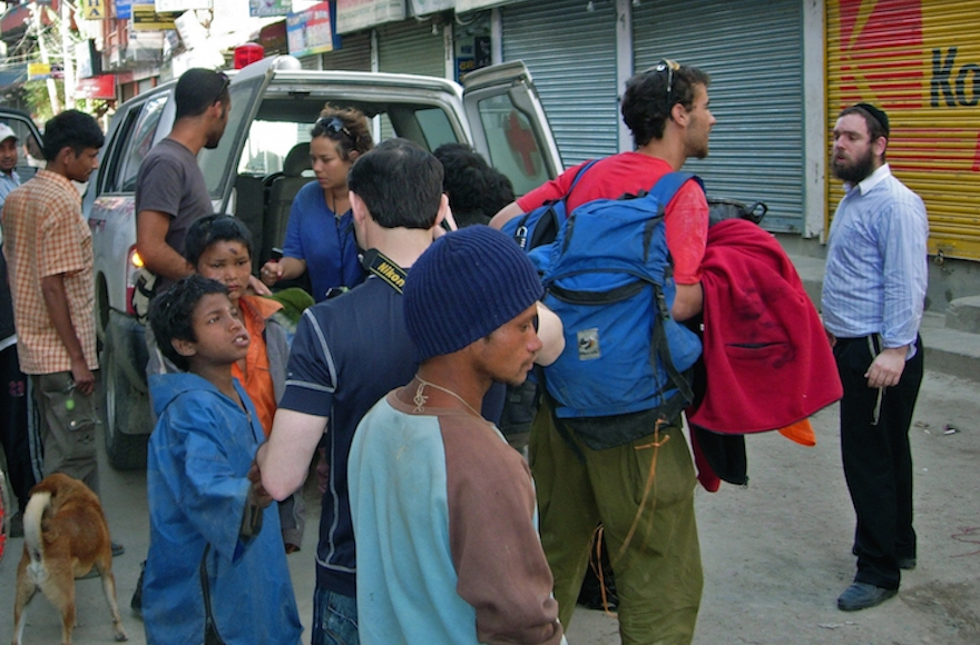 Rabbi Chezki Lifshitz, right, welcoming hikers into Kathmandu's Chabad House in March 2012. (Courtesy of Chabad Nepal.)