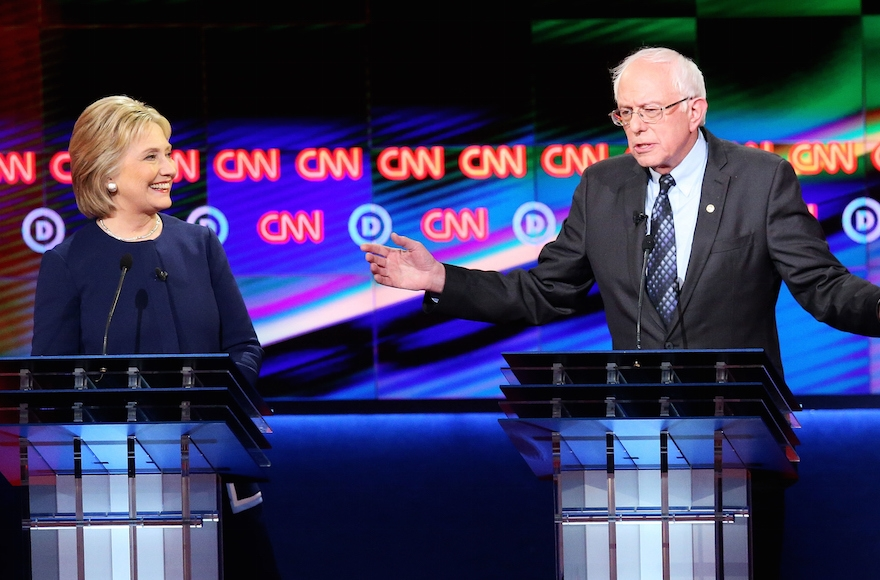 Democratic presidential candidate Senator Bernie Sanders, D-Vt, and Democratic presidential candidate Hillary Clinton speaking during the CNN Democratic Presidential Primary Debate at the Whiting Auditorium at the Cultural Center Campus in Flint, Michigan, March 6, 2016. (Scott Olson/Getty Images)