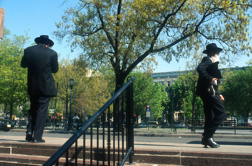 Orthodox Jewish men walking near Chabad international headquarters at 770 Eastern Parkway in Crown Heights, Brooklyn, New York, May 12, 2008. (Serge Attal/Flash90)