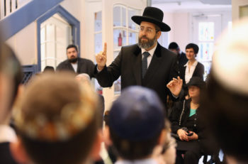 David Lau, Ashkenazi chief rabbi of Israel, speaking to children about the Kristallnacht pogroms at the Or Avner traditional Jewish school in Berlin, Germany, Nov. 8, 2013. (Sean Gallup/Getty Images)