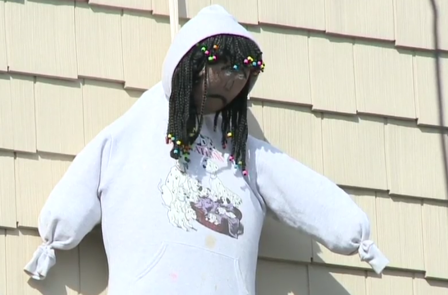 A doll hanging outside apparently a house apparently as a Purim decoration in Spring Valley, New York, March 24, 2016. (Screenshot from News12 Hudson Valley)