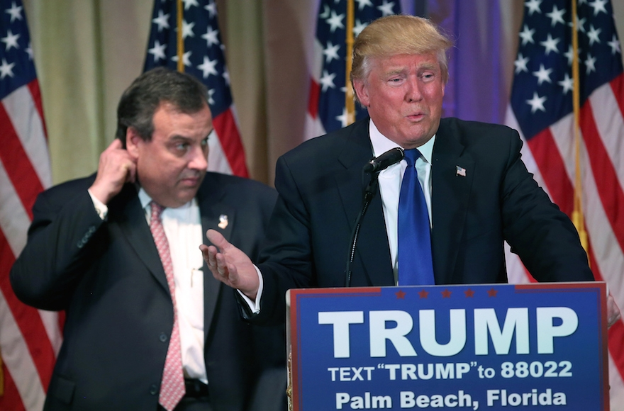 Donald Trump, right, speaking at a press conference with New Jersey Gov. Chris Christie in Palm Beach, Florida, March 1, 2016. Christie stood by, often distracted, as Trump held a press conference at his Mar a Lago Club after the polls closed on Super Tuesday.  (Photo by John Moore/Getty Images)