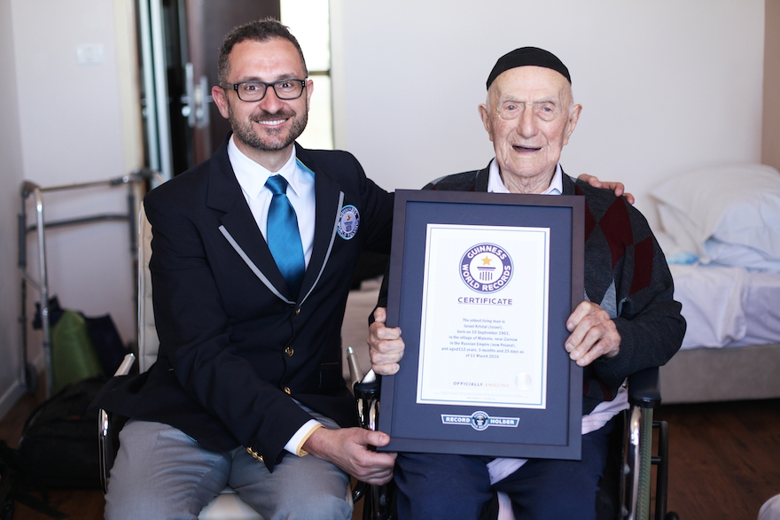 Marco Frigatti, Head of Records for Guinness World Records, presents Israel Kristal his certificate of achievement for Oldest living man on 11th March 2016, Haifa. (Courtesy of Guinness World Records)