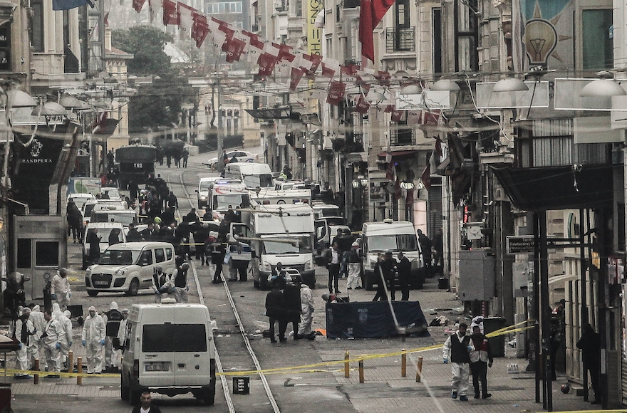 Emergency services inspecting the area following a suicide bombing in a major shopping and tourist district in the central part of Istanbul, Turkey, March 19, 2016 in Istanbul, Turkey. (Burak Kara/Getty Images)