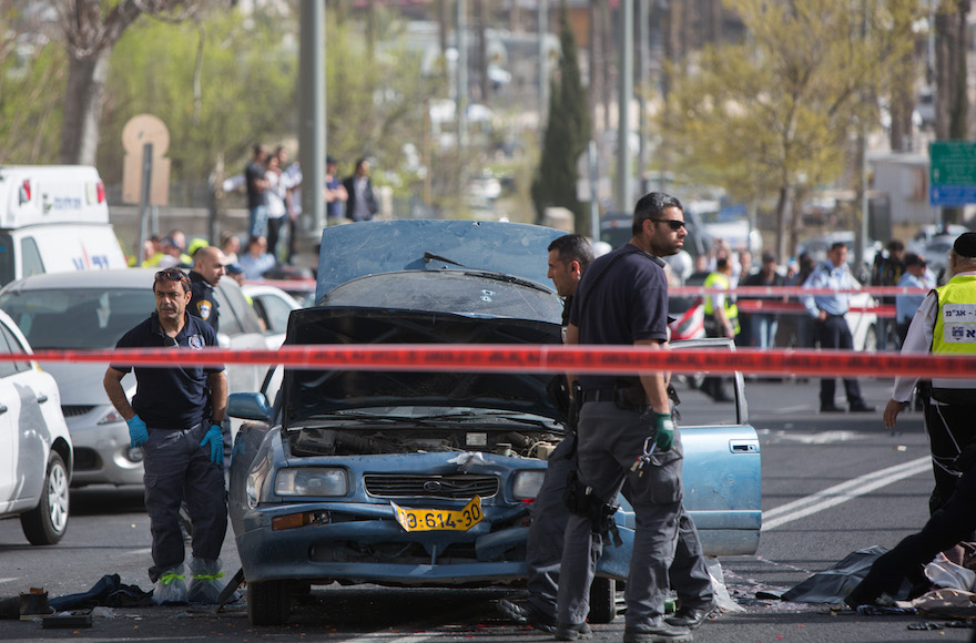 Israeli security at the scene where a man was seriously injured when a Palestinian attacker drove his vehicle into pedestrians, near the Old City of Jerusalem, Israel, March 9, 2016. (Yonatan Sindel/Flash90)