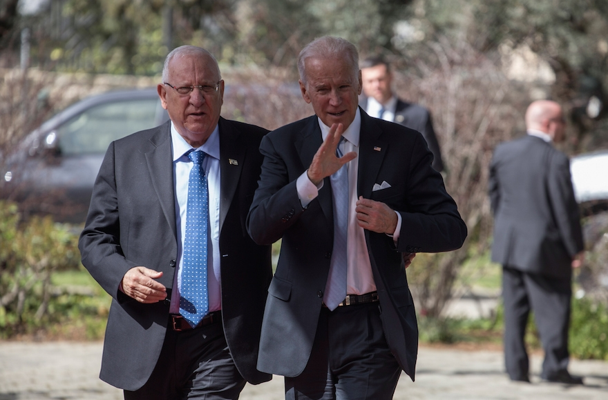 Vice President Joe Biden, right, walking with Israeli President Reuven Rivlin down the red carpet as they prepare to give a press conference in the Israeli presidential residence in Jerusalem, Israel, March 9, 2016. (Ilia Yefimovich/Getty Images)