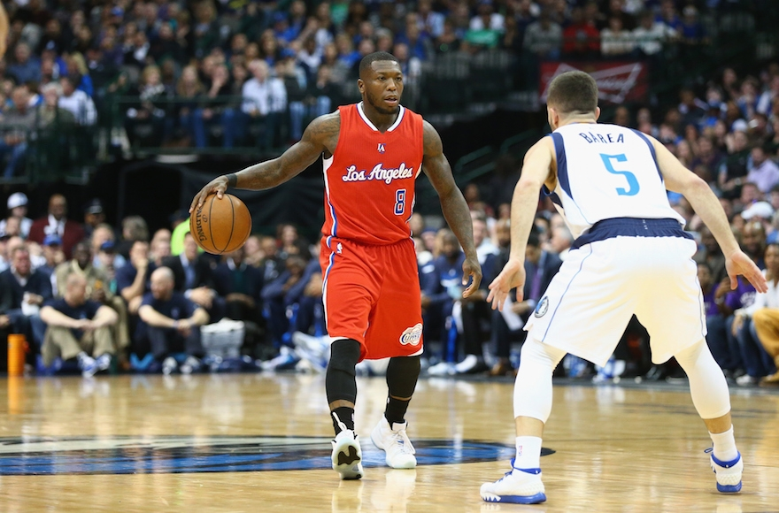 Nate Robinson, left, playing in a game against the Dallas Mavericks at American Airlines Center in Dallas, Texas, March 13, 2015. (Ronald Martinez/Getty Images)