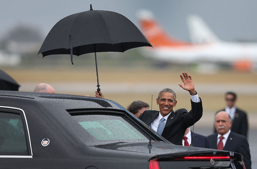 Barack Obama waving as he arrives at Jose Marti International Airport on Air Force One for a 48-hour visit in Havana, Cuba, March 20, 2016. (Joe Raedle/Getty Images)
