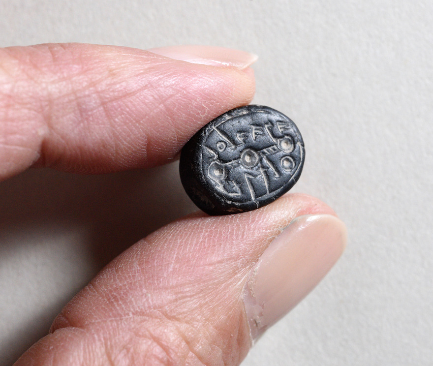 "A seal bearing the inscription: ""to Elihana bat Gael"" Clara Amit/Israel Antiquities Authority)"