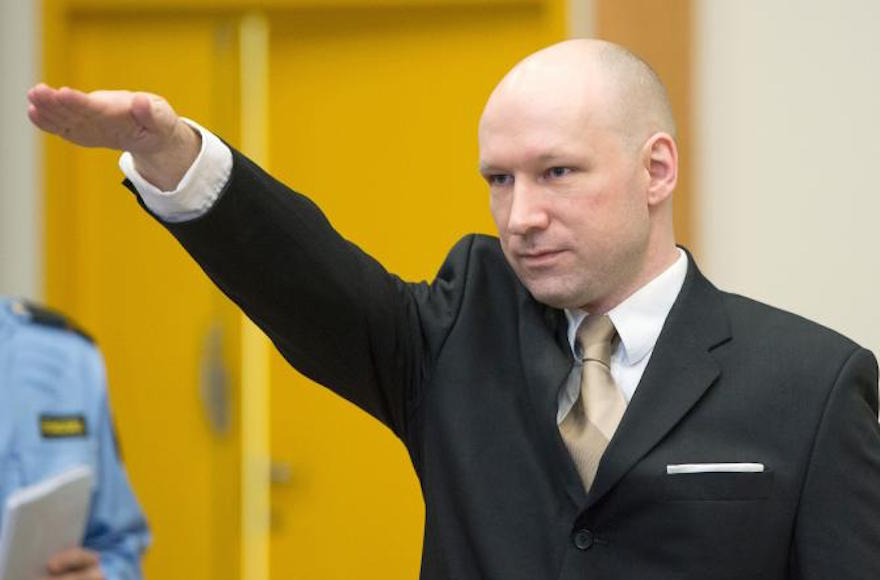 Norwegian mass killer Anders Behring Breivik making a Nazi salute as he arrives to a makeshift court in Skien prison, southwest of Oslo, for his lawsuit against the Norwegian state, March 15, 2016.