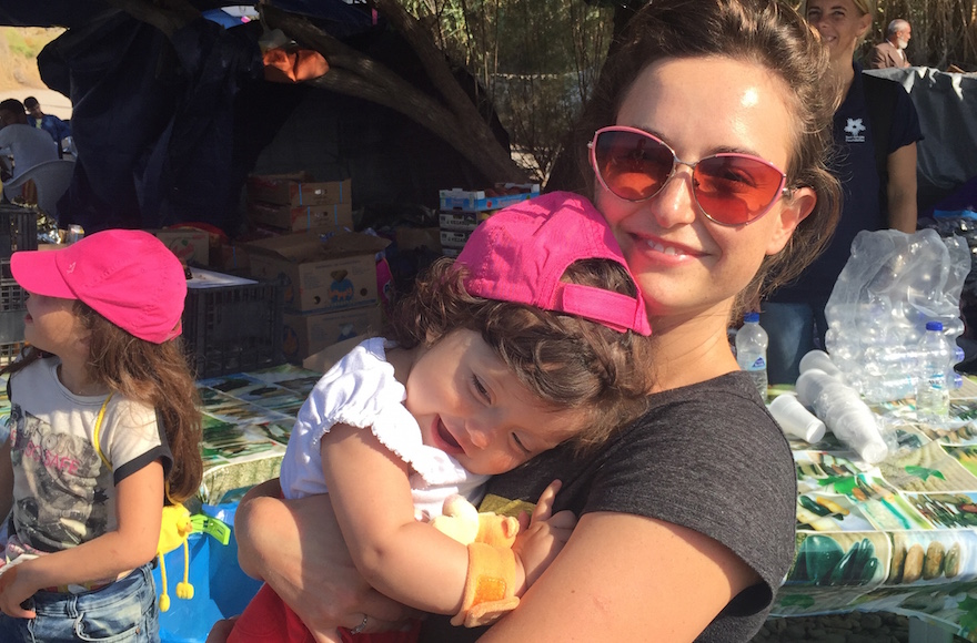 "Actress Milana Vayntrub, the ""AT&T Girl,"" volunteering with Syrian refugees in Lesbos, Greece. (Courtesy of Milana Vayntrub/Can't Do Nothing)"