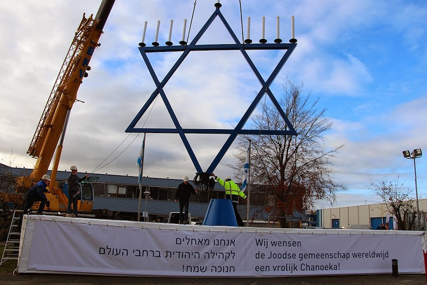 Workers installing a 36-foot menorah outside the Dutch headquarters of Christians for Israel, December 2013. (Courtesy of Christians for Israel)