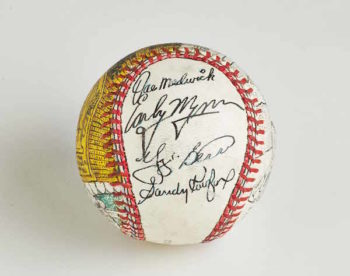 Another one of Jeff Aeder's prized possessions is a custom baseball signed by Sandy Koufax and other Hall of Famers, like Yogi Berra. (Courtesy of Jeff Aeder)