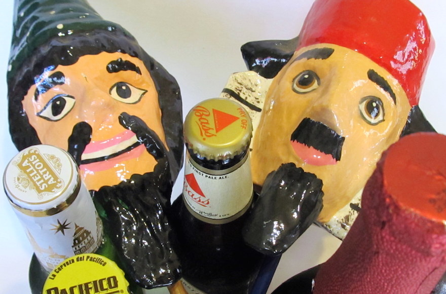Groggers and beer — two important elements of a Purim celebration. (Edmon Rodman)