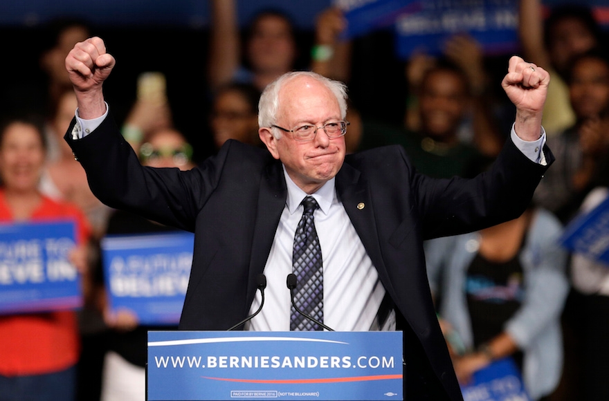 Democratic presidential candidate Bernie Sanders acknowledging supporters at a campaign rally in Miami, Florida, March 8, 2016. (AP Photo/Alan Diaz)