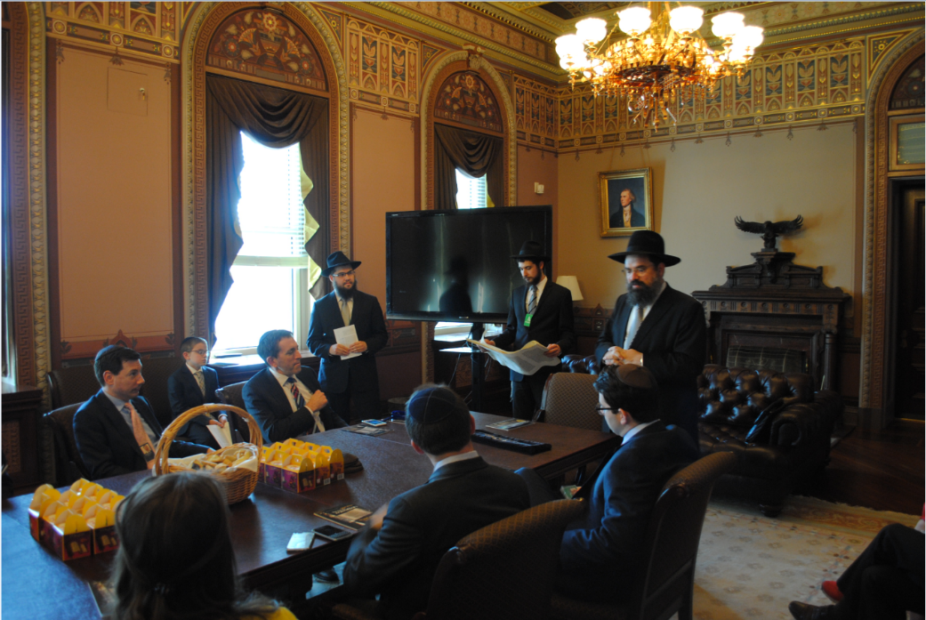 Matt Nosanchu, seated, left attends a Purim Megillah reading at the Diplomatic Reception Room on March 24. (White House)