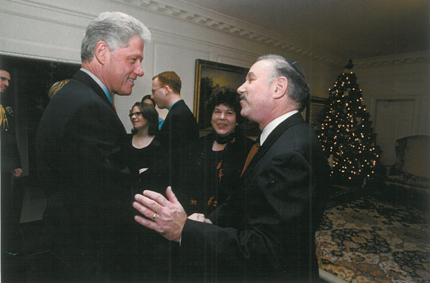 Bob and Helene Fine meet President Bill Clinton at the White House in December 2000, a few months after hosting First Lady Hillary Clinton and Chelsea for Passover seder. (Courtesy of Bob Fine)