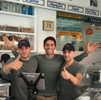 "Alex Frankel, left, and Zach Frankel, right, with Nev Schulman from the MTV show ""Catfish"" inside Frankel's Delicatessen. (Screenshot from Instagram)"