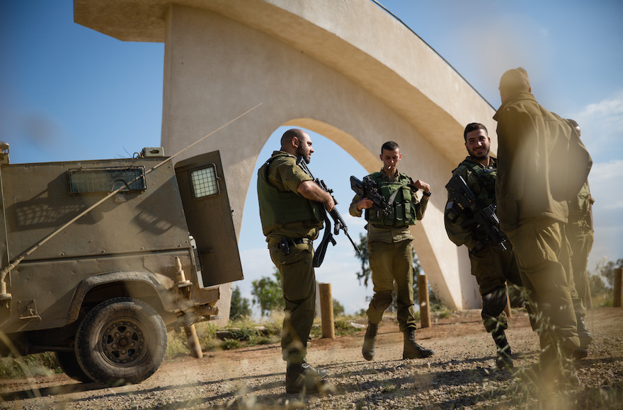 Israeli soldiers patrolling at the Anzac Memorial just outside the central Gaza strip in southern Israel,  on April 13, 2016. (Corinna Kern/Flash90)