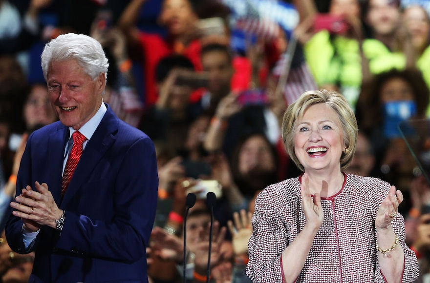 Hillary Clinton walking on stage with her husband Bill Clinton in New York City after winning the highly contested New York primary, April 19, 2016. (Spencer Platt/Getty Images)