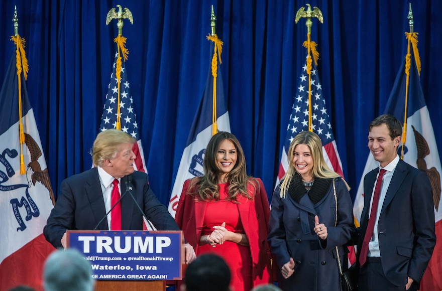 Republican presidential candidate Donald Trump, left, standing on with his wife Melania Trump, daughter Ivanka Trump and son-in-law Jared Kushner (left to right) at a campaign rally at the Ramada Waterloo Hotel and Convention Center in Waterloo, Iowa, Feb. 1, 2016. (Brendan Hoffman/Getty Images)